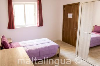 Chambre simple du logement de notre école