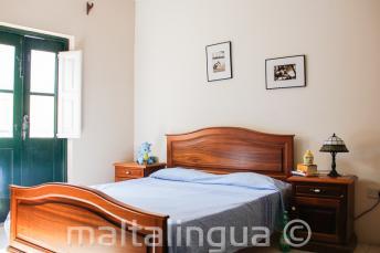 Une chambre du logement en famille d'accueil à St Julains